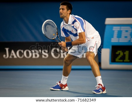 MELBOURNE - JANUARY 25: Novak Djokovic of Serbia in his quarter final match against  Tomas Berdych of the Czech Republic in the 2011 Australian Open final on January 25, 2011 in Melbourne, Australia.