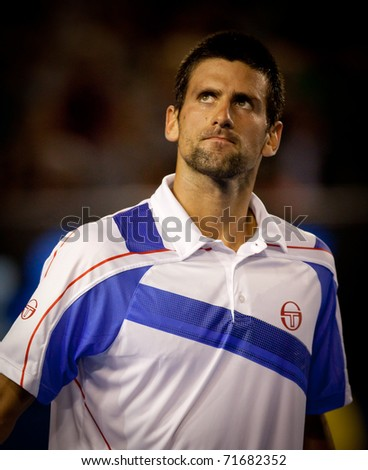 MELBOURNE - JANUARY 25: Novak Djokovic of Serbia in his quarter final match against  Tomas Berdych of the Czech Republic in the 2011 Australian Open final on January 25, 2011 in Melbourne, Australia. - stock photo