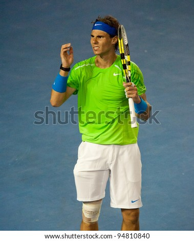 MELBOURNE - JANUARY 29: Rafael Nadal of Spain in his loss in the final to Novak Djokovic of Serbia at the 2012 Australian Open on January 29, 2012 in Melbourne, Australia.