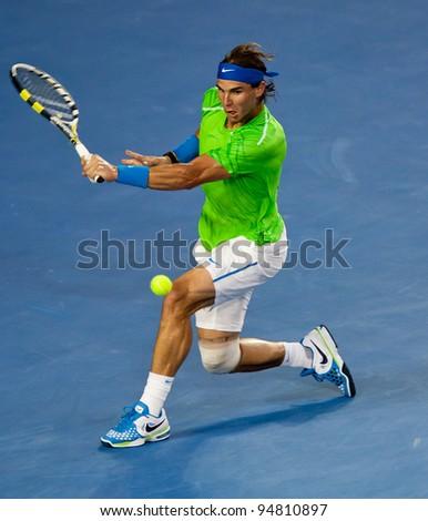MELBOURNE - JANUARY 29: Rafael Nadal of Spain in his loss to Novak Djokovic of Serbia in the final of  the 2012 Australian Open on January 29, 2012 in Melbourne, Australia.