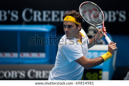 MELBOURNE - JANUARY 25: Roger Federer of Switzerland in his quarter final  win over Stanislas Wawrinka of Switzerland in the 2011 Australian Open on January 25, 2011 in Melbourne, Australia.