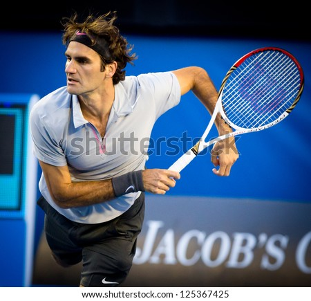 MELBOURNE - JANUARY 19:  Roger Federer of Switzerland in his third round win over Berbard Tomic of Australia at the 2013 Australian Open on January 19, 2013 in Melbourne, Australia.