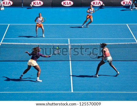 MELBOURNE - JANUARY 22: Serena (L Front) and Venus Williams in a doubles match against Sara Errani and Roberta Vinci of Italy at the 2013 Australian Open on January 22, 2013 in Melbourne, Australia.