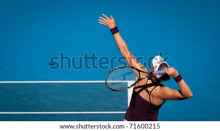 MELBOURNE - JANUARY 27: Vera Zvonareva of Russiain plays in her semi final loss to  Kim Clijsters of Belgium  in the 2011 Australian Open on January 27, 2011 in Melbourne, Australia - stock photo