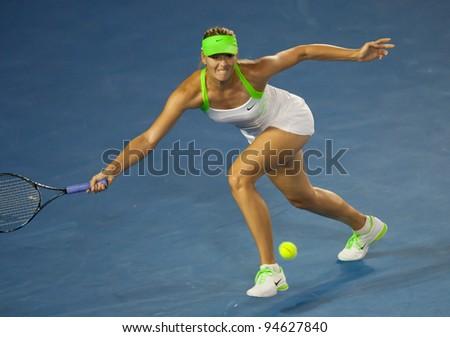 MELBOURNE - JANUARY 28: Victoria Azarenka of Belarus in her championship win over Maria Sharapova of Russia at the 2012 Australian Open on January 28, 2012 in Melbourne, Australia. - stock photo