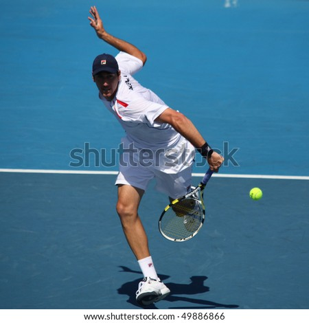 MELBOURNE - MARCH 6: Carsten Ball of Australia hits a volley in the doubles rubber of the Davis Cup tie against Chinese Taipei on March 6, 2010 in Melbourne