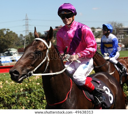 MELBOURNE - MARCH 13: Craig Williams on Boom 'n Zoom after the Roy Higgins Quality, won by Elmore at Flemington on March 13, 2010 - Melbourne, Australia.