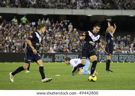 MELBOURNE - MARCH 20: Melbourne Victory captain Kevin Muscat (far R) proclaims his innocence in the  A-League grand final loss to Sydney FC on March 20, 2010 in  Melbourne.