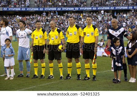 MELBOURNE - MARCH 20:Players and match referees lined up before the A-League League grand final won by Sydney FC over Melbourne Victory on March 20, 2010 in Melbourne