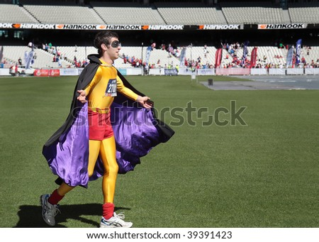 MELBOURNE - OCTOBER 11: A competitor dressed as an urban super hero in the final stages of the 2009 Melbourne marathon. October 11, 2009 in Melbourne.