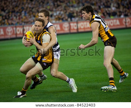 MELBOURNE - SEPTEMBER 9 : Brad Sewell (L) is tackled during Geelong's win over Hawthorn - September 9, 2011 in Melbourne, Australia.