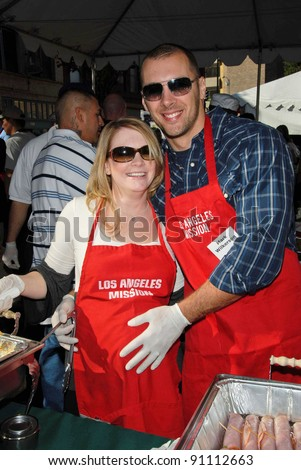 Melissa Joan Hart and Mark Wilkerson at the Los Angeles Mission's Christmas Eve Dinner for the Homeless. Los Angeles Mission, Los Angeles, CA. 12-24-07