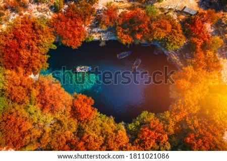 Melissani Cave with autumn colors. Famous Melissani lake on Kefalonia island, Karavomylos, Greece. On top of Melissani Cave (Melissani Lake) in Karavomylos village in Kefalonia island , Greece.