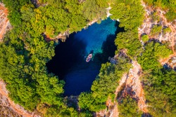 Melissani lake on Kefalonia island, Greece. Melissani Cave (Melissani Lake) near Sami village in Kefalonia island, Greece. Tourist boat on the lake in Melissani Cave, Kefalonia Island, Greece