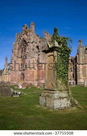 Melrose Abbey in the Scottish Borders is a beautiful and atmospheric red sandstone medieval ruin. It is also the poignant setting in which the embalmed heart of King Robert the Bruce was laid to rest. - stock photo