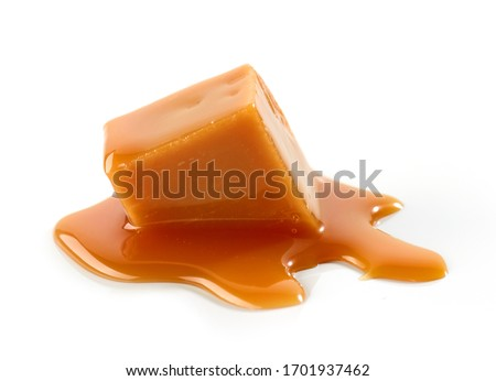 melted caramel candy isolated on white background