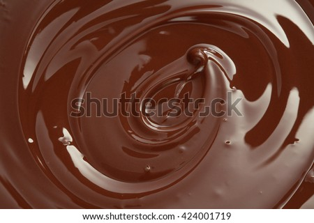 Melted chocolate swirl with a hazelnut/ melting chocolate/ chocolate swirl
