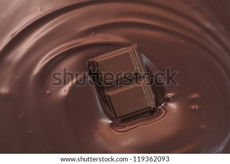 Melted chocolate swirl with  chocolate piece