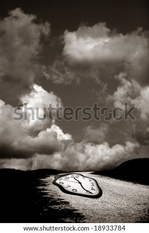 melted clock on the road with cloudy background