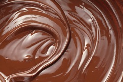 Melted dark chocolate swirl background