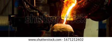 Melting furnace and factory equipment for cast iron and steel. The molten liquid metal is poured into the mold. ストックフォト ©