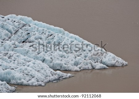 melting glacier, water dirty from volcano ash - stock photo