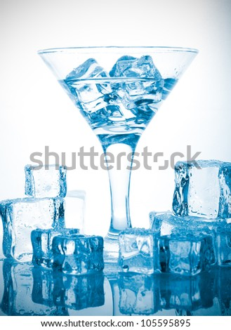 melting ice cubes and glass of alcohol