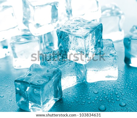 melting ice cubes on glass table.