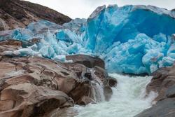 Melting Nigardsbreen Glacier, Jostedalsbreen National Park, Sogn og Fjordane, Norway, Scandinavia. Nigardsbreen is a glacier arm of the large Jostedalsbreen glacier