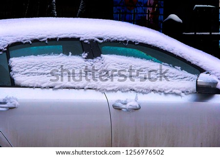 melting snow on the roof and windows of the car. Concept: thaw after snowfall, heavy snowfall. Soft focus #1256976502