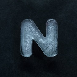 Melting speech. Alphabet's shiny and well-structured letters made out of ice isolated on dark studio background. Collect for combine in words. Copyspace to insert your advertising.