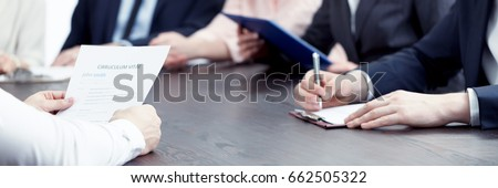 Member of management making notes of candidate's CV during interview