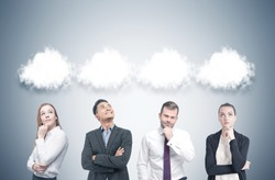 Members of a diverse business team are standing near a gray wall and thinking. There are thought clouds above their heads. Mock up