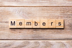 Members word written on wood block. Members text on wooden table for your desing, concept.