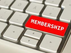 Membership on red computer keyboard