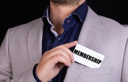 MEMBERSHIP text is written on the card that the businessman puts in his jacket pocket. Business concept.