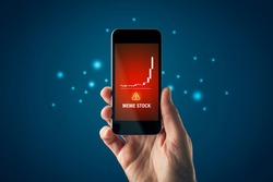 Meme stock investment warning concept with smart phone. Soaring graph of stock or cryptocurrency and notification about meme stock hazardous investment, risk and threat.