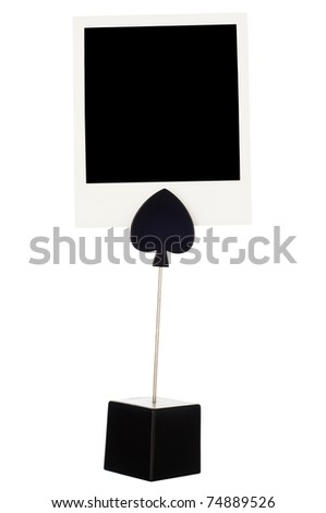 Memo holder with instant photo card isolated on a white background.