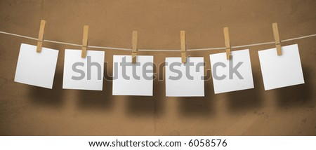 Memo on a leash on a textured background. - stock photo