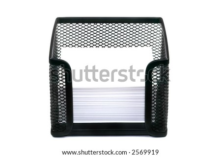 Memo pad in a black mesh block isolated against a white background, space on the blank memo's for copy