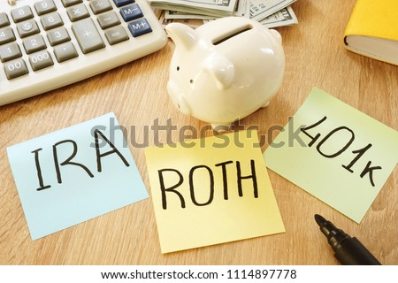 Memo sticks with words IRA 401k ROTH. Retirement plans.