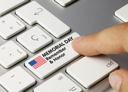 Memorial Day Remember  Honor Written on White Key of Metallic Keyboard. Finger pressing key.