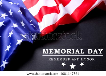 Memorial day weekend text written black chalkboard background with USA flag. United States of America stars & stripes patriot veteran remembrance symbol. Close up, copy space, top view. #1081149791