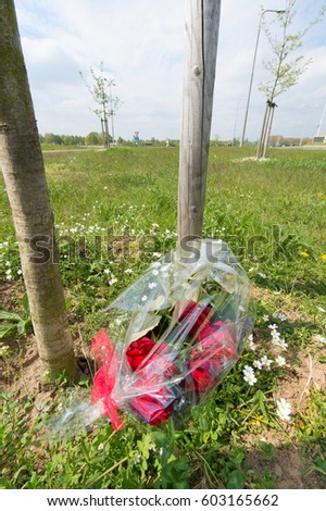 Memorial flowers near the road for somebody died by traffic accident