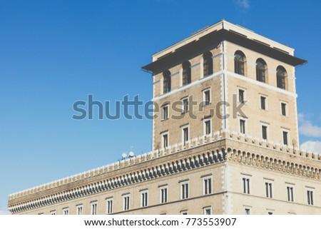 Memorial monument the Vittoriano or Altar of the Fatherland, in Venezia square, with waving italian flag. Italian and Rome patriotic symbols, located on the Campidoglio hill in Rome. #773553907