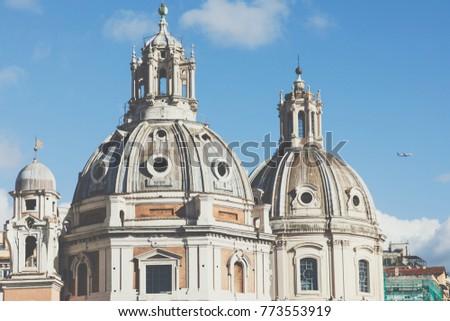 Memorial monument the Vittoriano or Altar of the Fatherland, in Venezia square, with waving italian flag. Italian and Rome patriotic symbols, located on the Campidoglio hill in Rome. #773553919