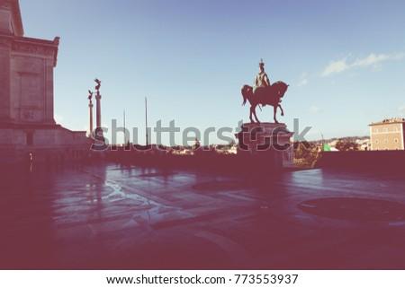 Memorial monument the Vittoriano or Altar of the Fatherland, in Venezia square, with waving italian flag. Italian and Rome patriotic symbols, located on the Campidoglio hill in Rome. #773553937