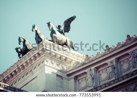 Memorial monument the Vittoriano or Altar of the Fatherland, in Venezia square, with waving italian flag. Italian and Rome patriotic symbols, located on the Campidoglio hill in Rome. #773553991