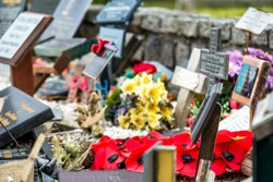 Memorial place for the fallen with poppies and crosses in Scotland