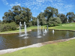 Memorial statue to pioneer women with fountains on lake in the foreground at Kings Park in Perth